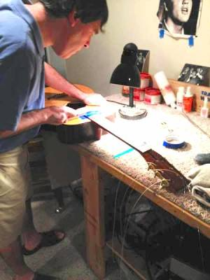 Michael repairing acoustic guitar